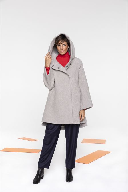 Flared hooded coat in putty color bouclé