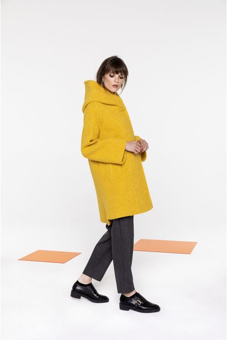Flared hooded coat in yellow bouclé