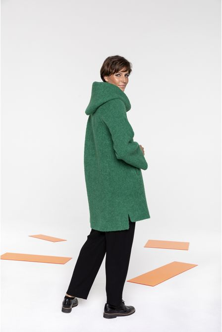 Flared hooded coat in green bouclé
