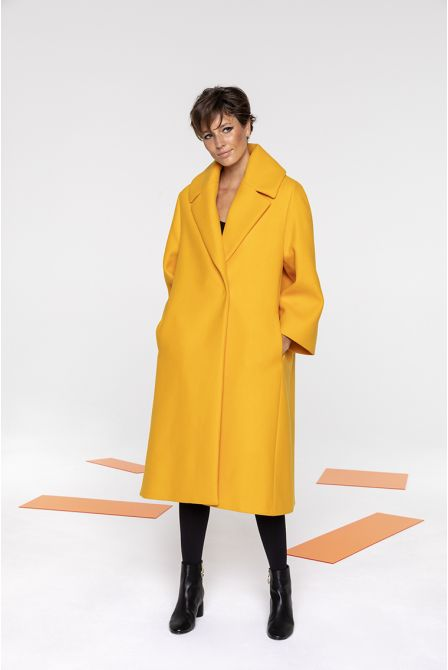 Flared long coat in yellow wool