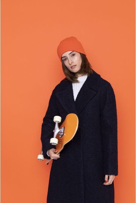 navy alpaca coat with a flared curly look