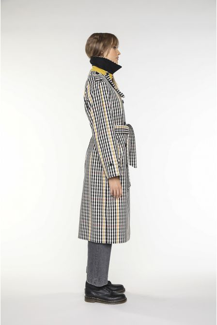 Trench coat in mixed black and creme cotton and wool.
