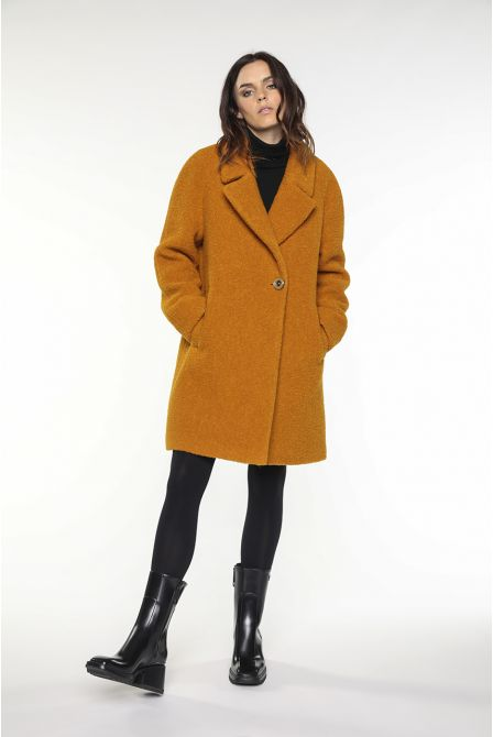 Yellow flared boucle coat in virgin wool