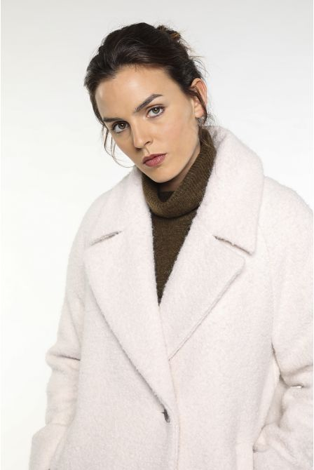 cream alpaca coat with a flared curly look