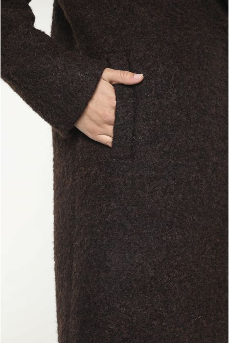 Brown colour coat in alpaca wool with a flared curly look
