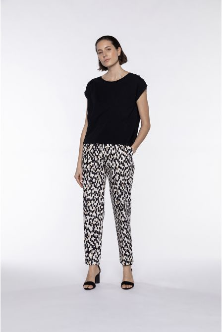 Fluid pants with elasticated waist and cream graphic patterns