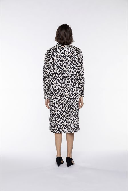 Oversized shirt dress with cream graphic patterns